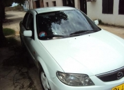 VENDO ESPECTACULAR MAZDA ALLEGRO 2003 1.3 COLOR BLANCO CON RADIO DVD